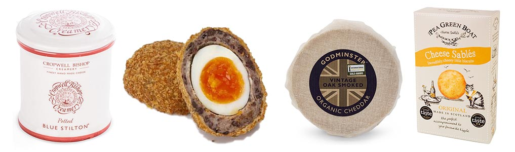A selection of cheese, crackers and a scotch egg