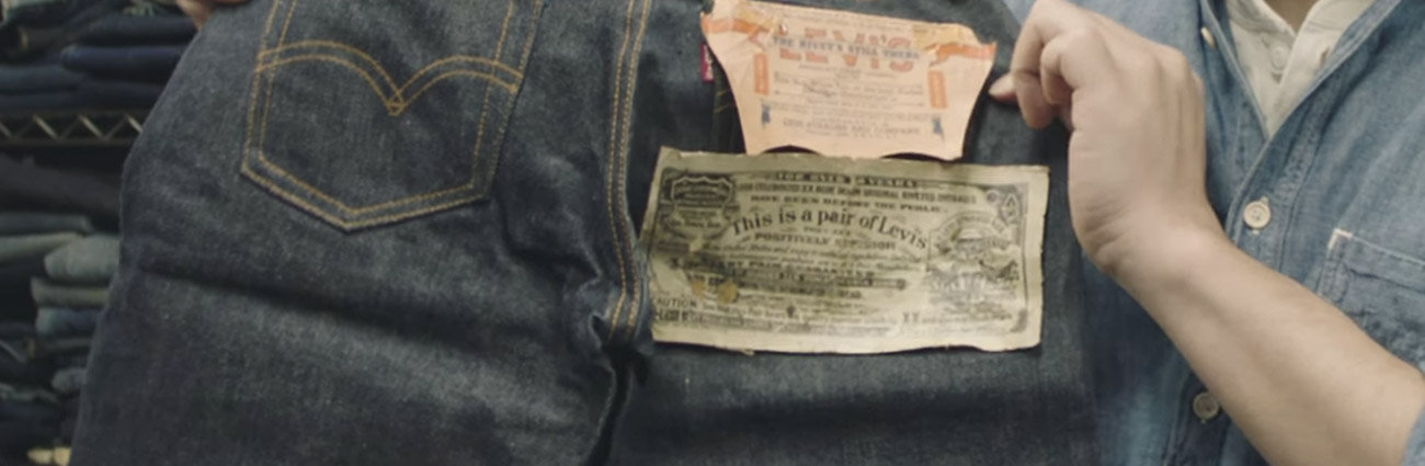 Levi jeans held up by worker showing original logo