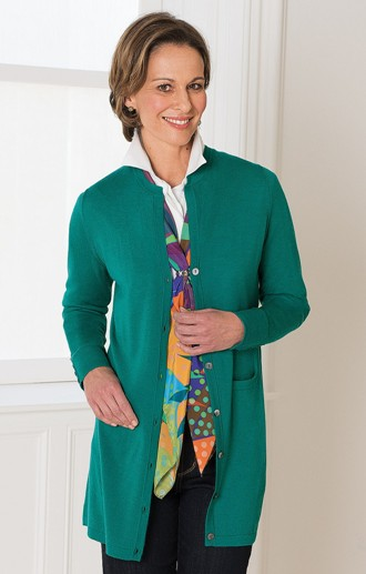 brunette model in longline green merino cardigan