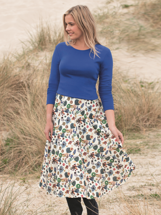 Sebago Liberty print House of Bruar exclusive blond model on beach in skirt